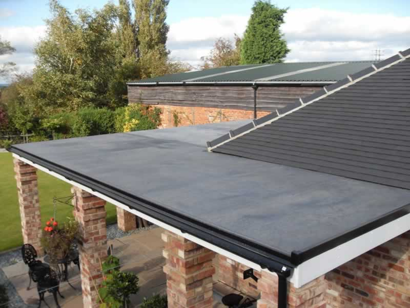 What Is the Difference Between A Flat Roof Replacement and A Sloped Roof Replacement?